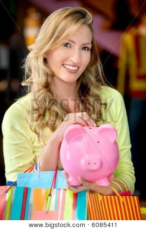 Woman With Bags And A Piggybank