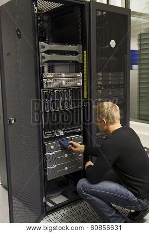 Technician Insert Backup Tape