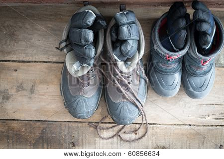 Adult Snow Boots Alongside Those Of A Child