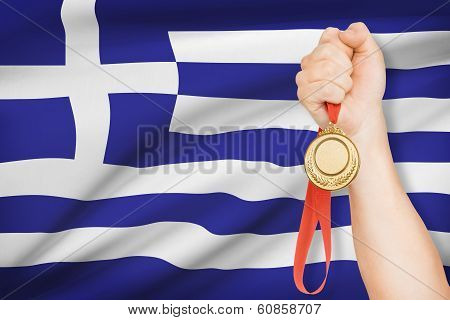 Medal In Hand With Flag On Background - Hellenic Republic
