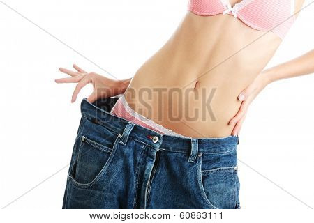 Woman showing how much weight she lost. Isolated