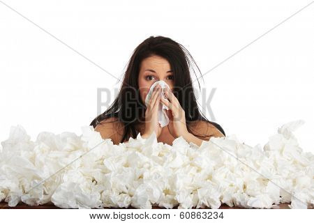 Young woman in lot of tissues around, ill, isoalted on white background