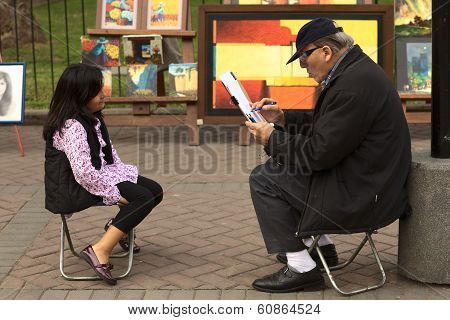 Man Drawing a Portrait of a Girl