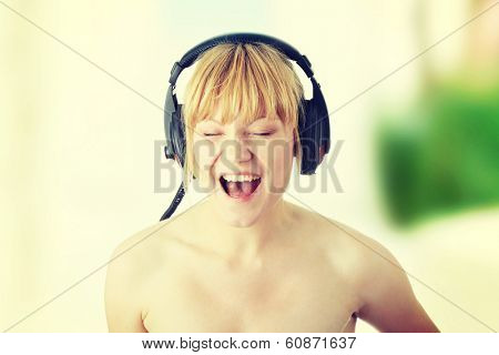 Young beautiful happy women listening agressive music in headphones