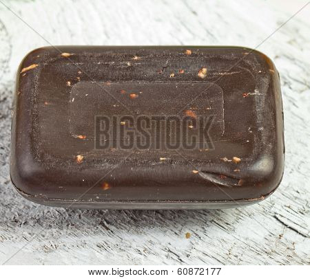 african black soap on white wood
