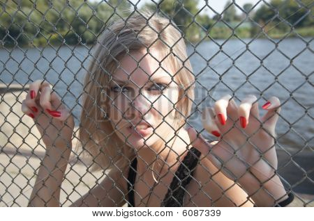 The girl has spitefully seized hands an  grid