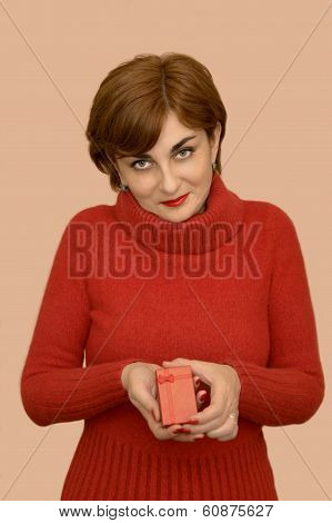Woman in red holding a gift