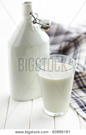 milk in glass on white wooden table