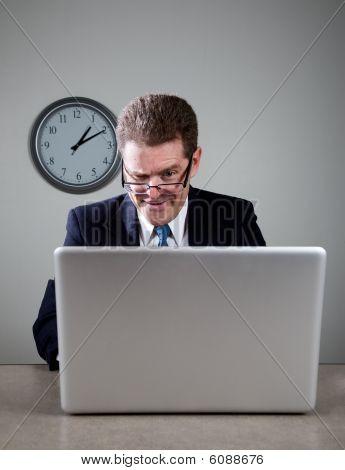 Crazy Businessman On Laptop Computer