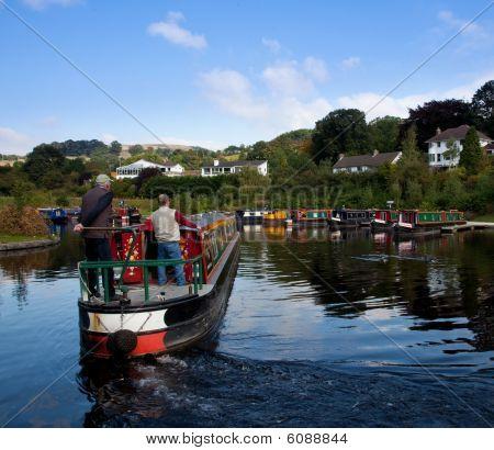 Two Men Steering A Barge Into A Boatyard Near Llangollen