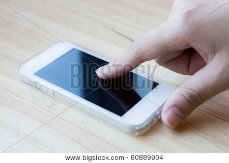 Hands holding and pointing on Smart Phone