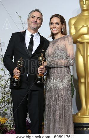 LOS ANGELES - MAR 2:  Alfonso Cuaron, Angelina Jolie at the 86th Academy Awards at Dolby Theater, Hollywood & Highland on March 2, 2014 in Los Angeles, CA