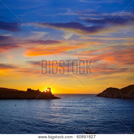 Menorca sunset in Cala Morell at Ses torretes beach Balearic Islands