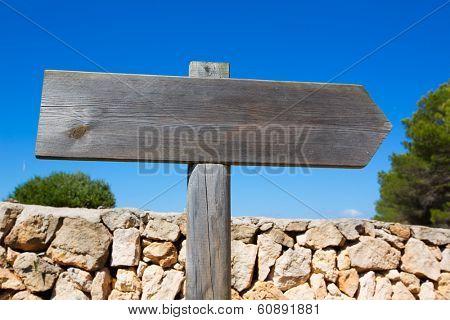 Wooden track blank road sign in Mediterranean Balearic islands