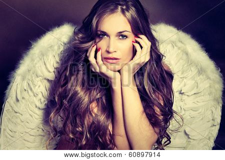 beautiful angel woman with white wings