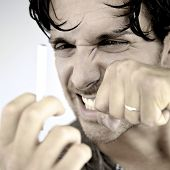 foto of stop fighting  - Angry man fighting with cigarette willing to stop smoking - JPG