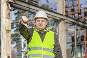 image of substation  - Disgruntled Electrical Engineer in the electric substation - JPG