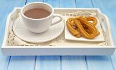 image of churros  - Cup of hot chocolate and several Churros - JPG