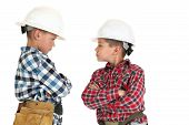 Two Boys Fighting Wearing Construction Hardhats Looking Tough