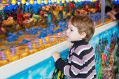 pic of funfair  - Little boy of three years at a funfair outdoors - JPG