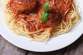 stock photo of meatballs  - Pasta spaghetti with meatballs and tomato sauce on a white plate on a table top view - JPG