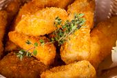 foto of high calorie foods  - Crispy fried crumbed chicken nuggets in a wicker basket served as a finger food or appetizer with a creamy dip in a bowl alongside - JPG