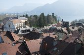 stock photo of annecy  - Large view of Annecy town and roof bordered by Annecy lake France - JPG