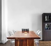stock photo of buffet  - Modern and Contemporary dining room table and decorations with blank wall for your text image - JPG
