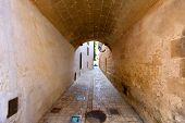 Menorca Ciutadella carrer del Palau barrel vault passage at Balearic islands