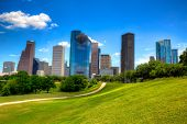 stock photo of highrises  - Houston Texas Skyline with modern skyscrapers and blue sky view from park lawn - JPG