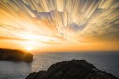 Unique Abstract Time Lapse Stack Sunrise Landscape Over Rocky Coastline