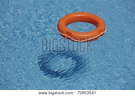 Orange Life Rings In Blue Water