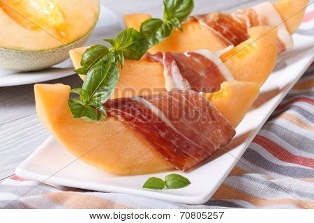 Pieces Of Melon Wrapped In Ham Horizontal Close-up