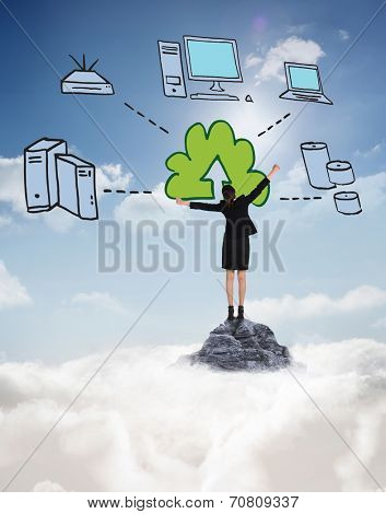 Excited businesswoman cheering against mountain peak through the clouds