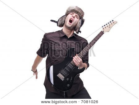 Guitar player jumping in midair
