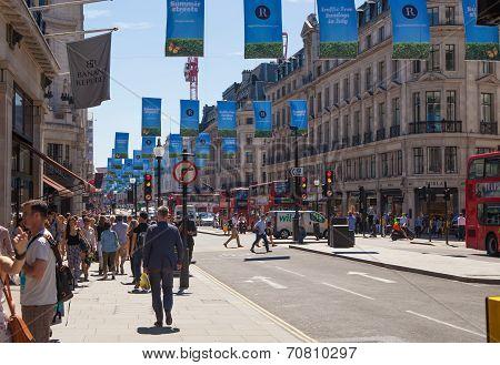 LONDON, UK - JULY 29, 2014: Regent street in London, tourists crossing the junction