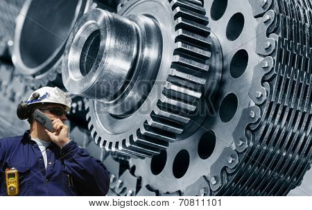 mechanic, worker with power driven cogwheels machinery, steel and metal industry