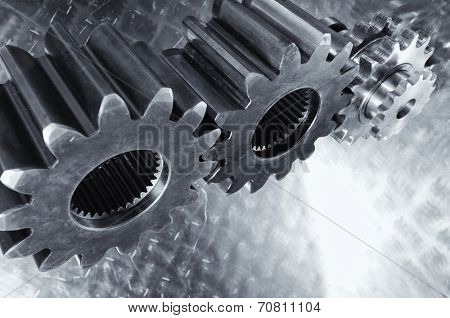 aerospace gears and cogwheels set against light titanium background