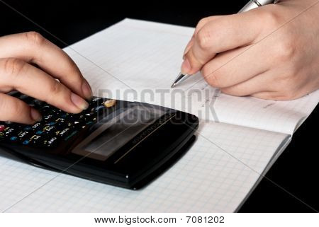 Woman Counting With A Calculator