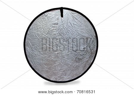 Isolated Photo Of A Photography Light Reflector In Silver