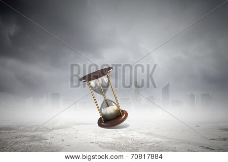 Conceptual image with huge sandglass. Time concept