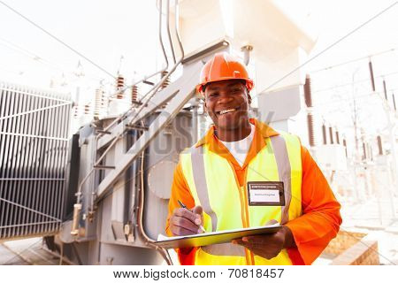 cheerful african electricity company substation worker