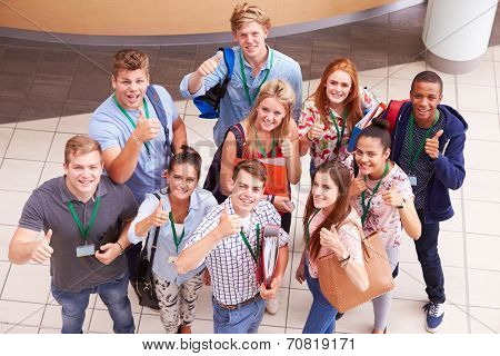 Overhead Portrait Of College Students Standing In Hallway