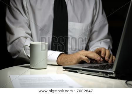 Business Man With Coffee Cup Working On Laptop