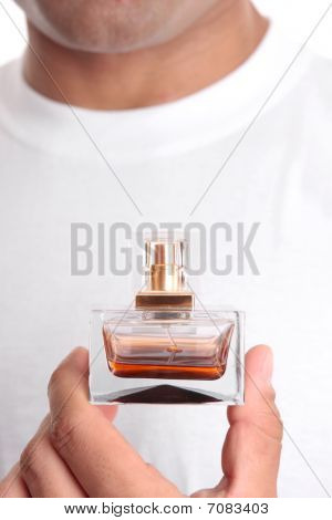 Man Holding Perfume Aftershave