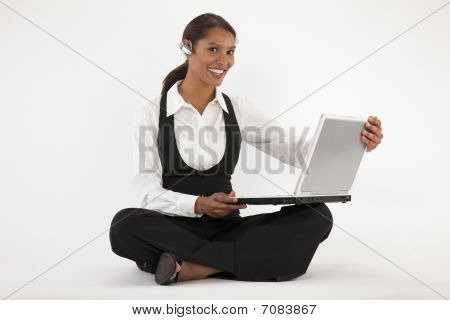 Young Woman Using Laptop And Blue Tooth