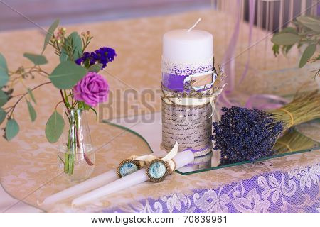 Decoration For Wedding Table In Purple Color . Flowers And Candles. The Bundle Of Laven