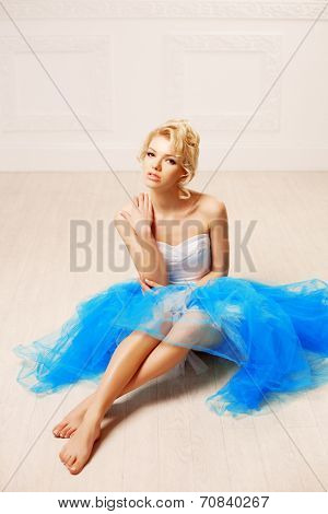 Dancer, ballerina. Cute woman looks like a doll in a sweet interior. Young pretty smiling girl