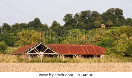 Ruined Building With Rusty Roof In A Landscape