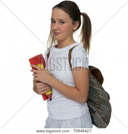 Young schoolgirl with her hair in pigtails and a backpack over her shoulder grimacing as she leaves for class clutching a book and pencil case, on white